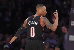 Portland Trail Blazers guard Damian Lillard gestures after scoring during the second half of an NBA basketball game against the Los Angeles Lakers, Sunday, Jan. 11, 2015, in Los Angeles.  The Heat won 106-94. (AP Photo/Mark J. Terrill)