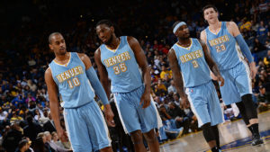 OAKLAND, CA - JANUARY 19: Arron Afflalo #10, Kenneth Faried #35, Ty Lawson #3, and Jusuf Nurkic #23 of the Denver Nuggets stand on the court during a game against the Golden State Warriors on January 19, 2015 at Oracle Arena in Oakland, California. NOTE TO USER: User expressly acknowledges and agrees that, by downloading and or using this photograph, user is consenting to the terms and conditions of Getty Images License Agreement. Mandatory Copyright Notice: Copyright 2015 NBAE (Photo by Noah Graham/NBAE via Getty Images)