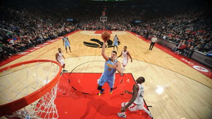 TORONTO, CANADA - OCTOBER 31:  Nikola Jokic #15 of the Denver Nuggets goes up for a shot during a game against the Toronto Raptors on October 31, 2016 at the Air Canada Centre in Toronto, Ontario, Canada.  NOTE TO USER: User expressly acknowledges and agrees that, by downloading and or using this photograph, user is consenting to the terms and conditions of the Getty Images License Agreement.  Mandatory Copyright Notice: Copyright 2016 NBAE (Photo by Ron Turenne/NBAE via Getty Images)